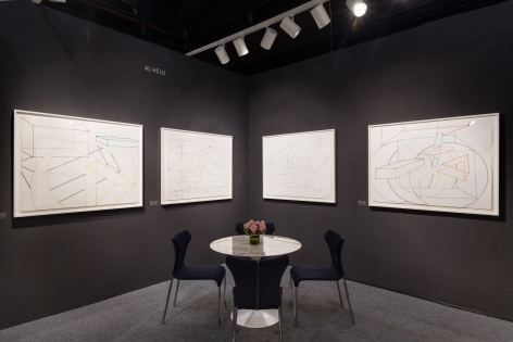 drawings installed on a grey wall