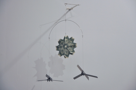 Abdullah M. I. Syed  Twinkle Twinkle Little Drone - III   2016  Altered toy mobile, banknotes, stainless steel, plastic and metal wire  20 x 18 in