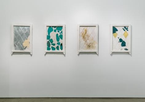 An installation of artwork by Julie Schenkelberg. Mixed media pieces line the walls