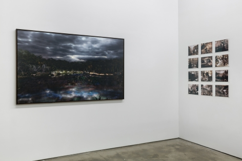 """An installation view of Jasper de Beijer's exhibition, """"The Brazilian Suitcase"""". Framed photographs are on the walls. Small pieces are arranged in a grid."""