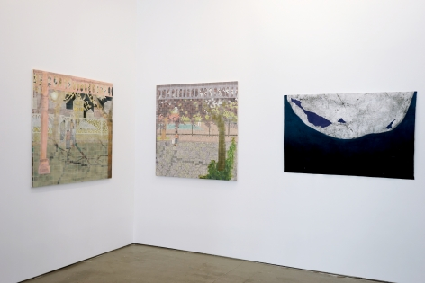 This is an installation view of the group exhibition Counter Narratives: Geographies of the Unfamiliar, which features paintings on the walls.