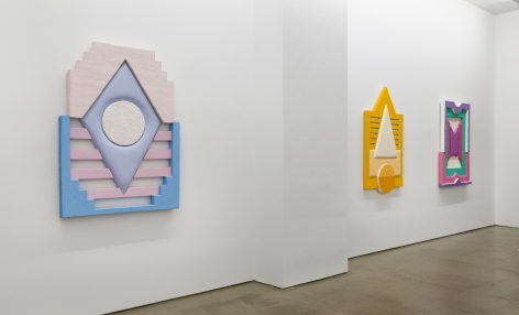Installation views of Leah Guadagnoli's solo exhibition. Geometric sculptures made from fabric, foam, and pumice stone line the walls.