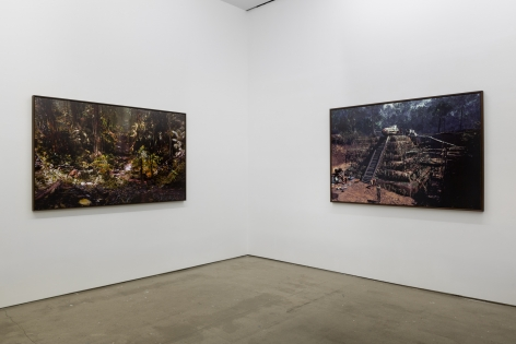 "An installation view of Jasper de Beijer's exhibition, ""The Brazilian Suitcase"". Framed photographs are on the walls."