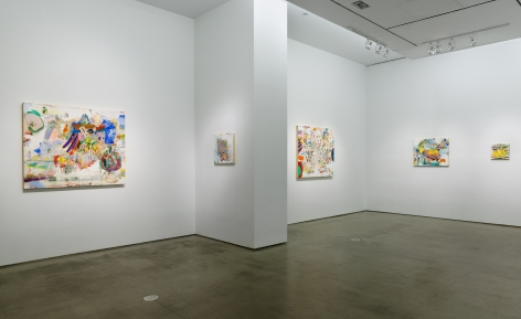 Installation image of Carolyn Case's solo exhibition. Paintings line the gallery walls by a column