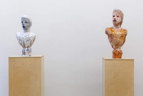Two busts on separate pedestals