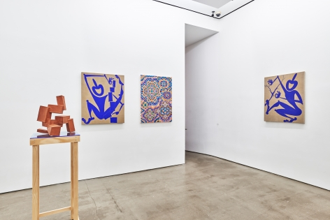 Installation view of works by Todd Kelly. Paintings and sculptures are next to each other. There is a doorway on the right