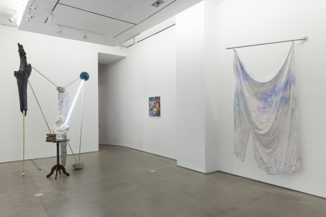 installation of sculptures, textiles, and paintings
