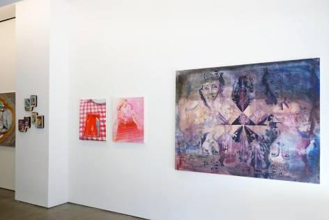 This is an installation view of the group exhibition Counter Narratives: Geographies of the Unfamiliar, which features paintings on the walls. There is a large piece in the foreground, next to a column.