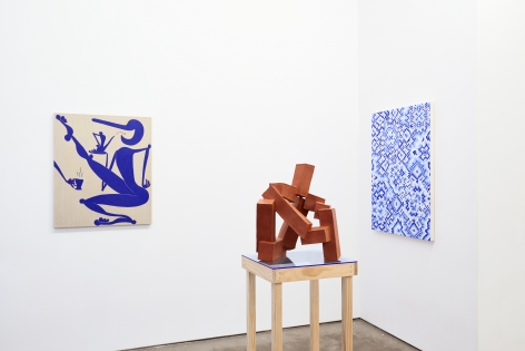 Installation view of works by Todd Kelly. Paintings and sculptures are next to each other.