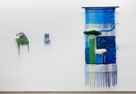"Installation view of ""Adriadne Unraveling"". Three textile works are hung on the wall."
