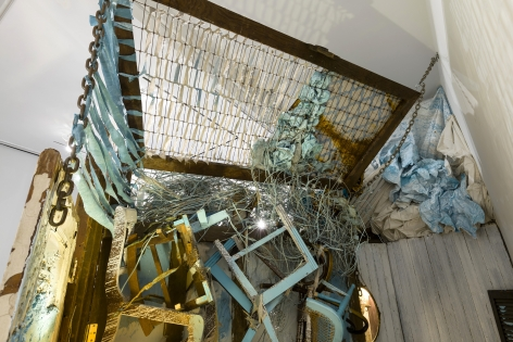 Large installation by Julie Schenkelberg including reclaimed wood and household materials