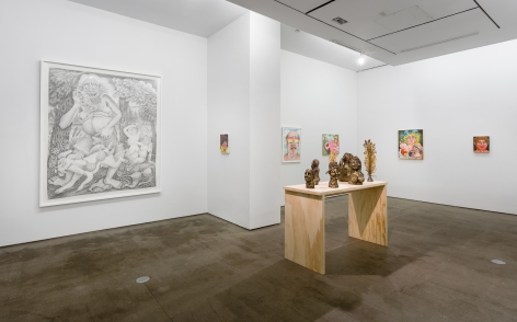 "Installation view of ""Town and Country"" by Rebecca Morgan. Sculptures on a table and paintings and prints on the wall"
