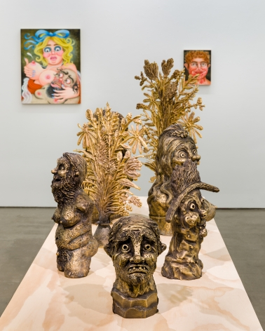 """Installation view of """"Town and Country"""" by Rebecca Morgan. Sculptures on a table and paintings and prints on the wall"""