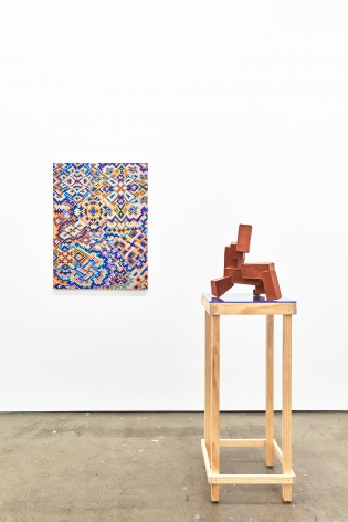 Installation view of works by Todd Kelly. A painting and sculpture are next to one another