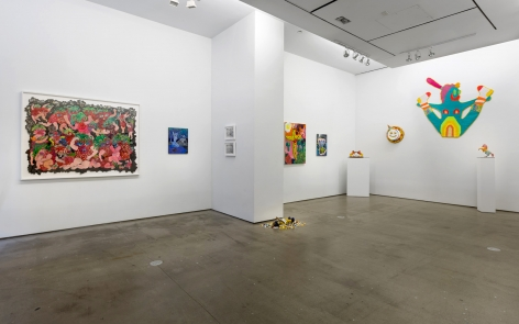Installation view of ALIVE WITH PLEASURE!, which features a mix of artworks on hung on the walls and sculptures on pedestals and on the floor.