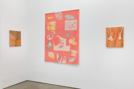 Three textile works are hung on the wall.