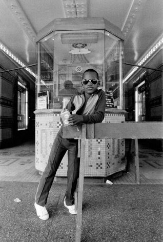 DAWOUD BEY, A Boy in Front of the Loew's 125th Street Movie Theatre, Harlem, NY, 1976
