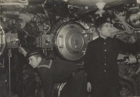 Torpedo gunners on board a submarine