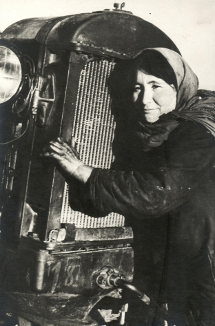 Woman Hugging Tractor, ca. late 1920s-early 1930s