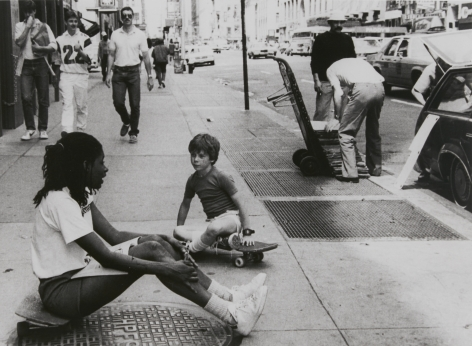 Rudy Burckhardt Untitled, New York (girl and young boy seated on skateboard in middle of sidewalk), c. 1985