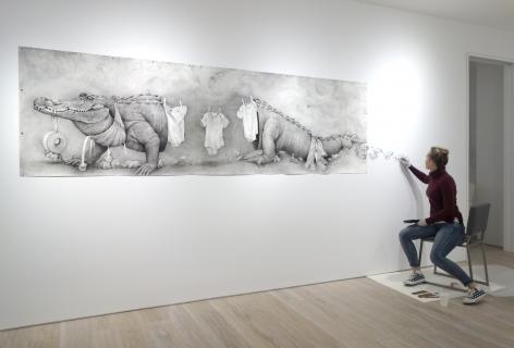 Adonna Khare installing her work Alligator Clothesline (2016)