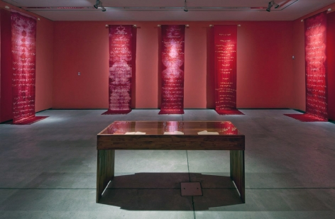 Reena Kallat, Walls of the womb, 2007, tied-and-dyed silk, handwritten recipe books,installation atArken Museum in Denmark, Courtesy of Nature Morte, New Delhi, photo by Anders Sune Berg