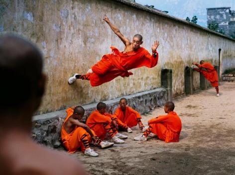 , Steve McCurry, Monk Running on Wall, China, 2004, ultrachrome print, 40 x 60 inches/101.6 x 152.4 cm; © Steve McCurry