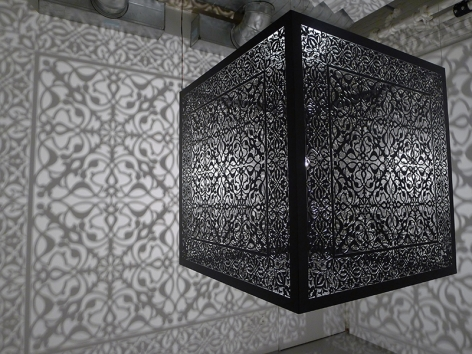 Anila Quayyum Agha, Shimmering Mirage, 2016, lacquered steel and halogen bulb, 36 x 36 x 36 inches/91.4 x 91.4 x 91.4 cm