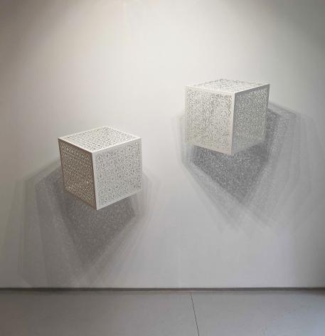 Itinerant Shadows - White (Bola and Arches), white laser-cut lacquered steel & light bulbs, 24 x 24 x 24 inches/61 x 61 x 61 cm each