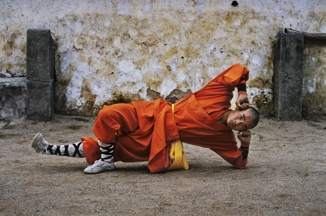 Young monk practicing Shaolin, one of the oldest styles of Kung Fu, Shaolin Monastery, Henan Province, China, 2004, chromogenic print, 20 x 24 inches/50.8 x 61 cm
