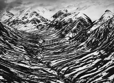 Sebastião Salgado, Bighorn Creek in the western part of the Kluane National Park, Canada, 2011, gelatin silver print, 60 x 80 inches / 153 x 204 cm.
