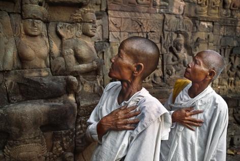Buddhist nuns at the Leper King Terrace, Angkor Wat, Cambodia, 1998, chromogenic print, 20 x 24 inches/50.8 x 61 cm