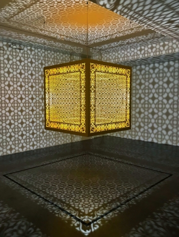 Anila Quayyum Agha, Hidden Diamond - Saffron, 2019, laser-cut, lacquered steel, 48 x 48 x 48 inches/122 x 122 x 122 cm