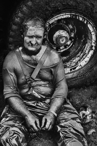 An exhausted firefighter, Oil wells, Greater Burhan, Kuwait, 1991, gelatin silver print, 24 x 20 inches/61 x 50.8 cm © Sebastião Salgado/Amazonas Images