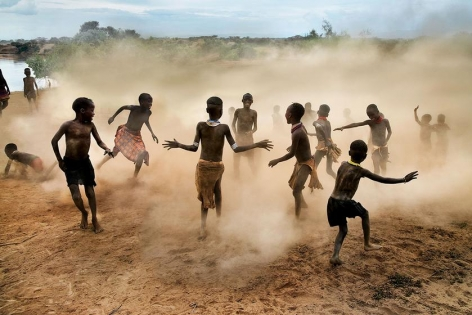 , Steve McCurry, Children of the Hamer Tribe playing in Dus Village, Omo Valley, Ethiopia, 2012, ultrachrome print, 30 x 40 inches/76.2 x 101.6 cm; © Steve McCurry
