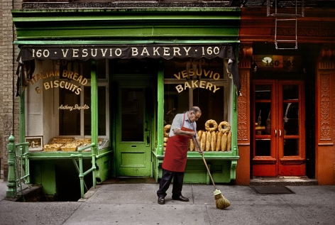 A man sweeps outside a bakery, New York, NY, USA,1996,chromogenic print, 20 x 24 inches/50.8 x 61 cm