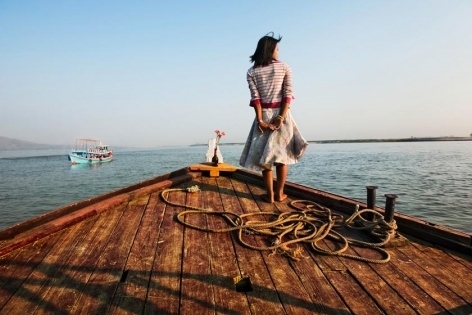 , Steve McCurry, Girl on Ship Prow, Burma, 2011, ultrachrome print, 40 x 60 inches; © Steve McCurry
