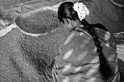 Woman's head with flowers in her hair, India [coffee plantation] © Sebastião Salgado/Amazonas Images, 2003