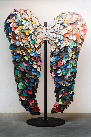 Last Flight, 2009, used slippers and metal stand, 107.3 x 77.2 inches/275 x 198 cm