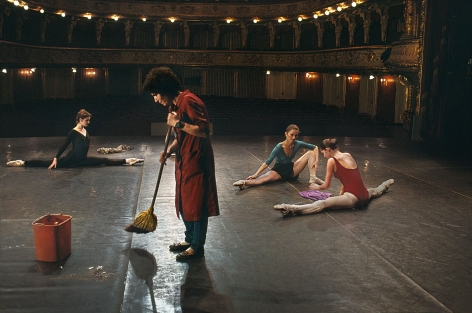 Man sweeps on stage while ballerinas stretch, National Ballet, Zagreb, Croatia, 1989, chromogenic print, 20 x 24 inches//50.8 x 61 cm