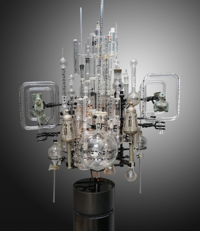 Genesis Series 2021-A, 2021, mixed-media, assemblage sculpture with vintage laboratory beakers, flasks and tubes with the Genesis text in Hebrew, antique Torah scroll finials, vintage bronze rhytons and tubular lights with steel base, 44 x 32 x 25 inches/111.8 x 81.3 x 63.5 cm