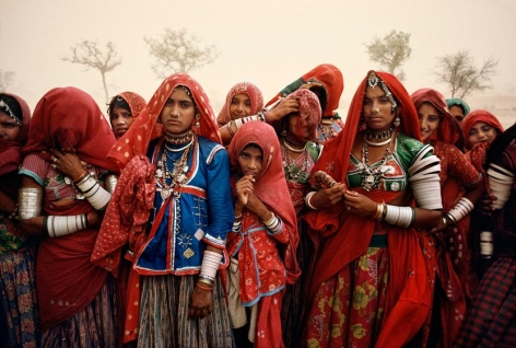 , Steve McCurry, Cluster of Women in Dust Storm, India, 1983, ultrachrome print, 40 x 60 inches; © Steve McCurry