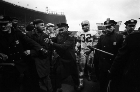 Cleveland Browns' Jim Brown Walking Off Field Victorious, NFL Championship game vs Baltimore Colts, Municipal Stadium, Cleveland, OH, 1964, Silver Gelatin Photograph