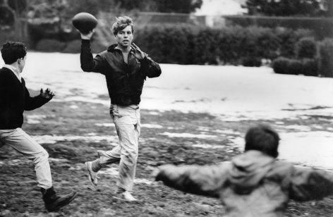Robert Kennedy at Home, Hickory Hill (throwing football), 1967, Silver Gelatin Photograph
