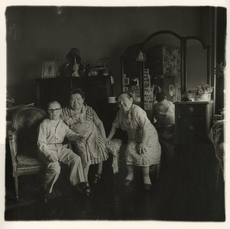 Diane Arbus Russian midget friends in a living room on 100th Street, N.Y.C.