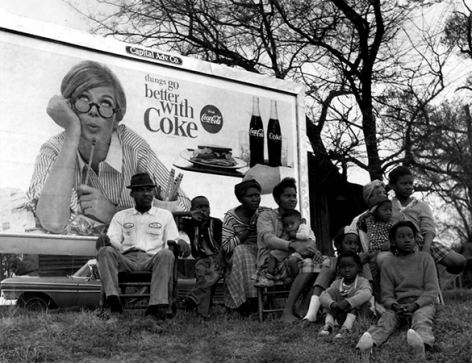 """Things Go Better With Coke"" sign and multi-generational family watching marchers, Selma To Montgomery Civil Rights March, March 25, 1965"