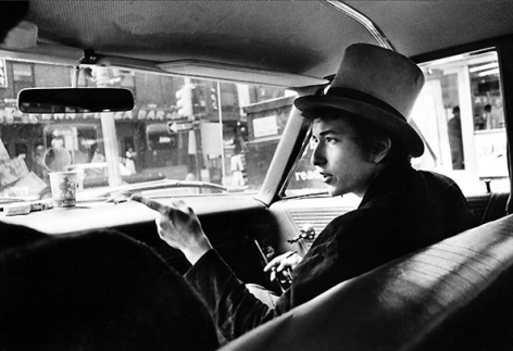 Bob Dylan with Top Hat Pointing in Car, Philadelphia, PA, 1964