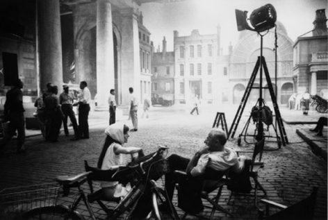 Audrey Hepburn & George Cukor chat after filming has finished for the day, on the Covent Garden set of My Fair Lady, 1963
