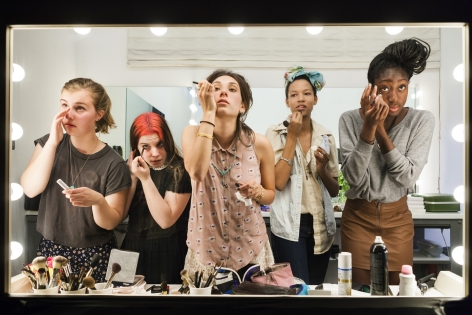 "High school seniors (from left) Lili, 17, Nicole, 18, Lauren, 18, Luna, 18, and Sam, 17, put on their makeup in front of a two-way mirror for ""Beauty CULTure,""Los Angeles, CA, 2011, 26 3/4 x 40 Inches, Archival Pigment Print, Combined Edition of 25"