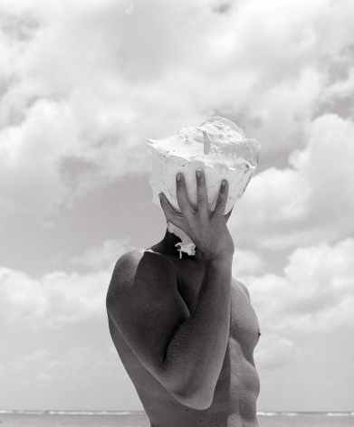 Man Holding Shell, Australia, 1986, 20 x 16 Inches, Silver Gelatin Photograph, Edition of 25